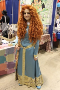 """Sarah Siemers UNM graduate  Costume: Meredith from Brave  How long did it take to make your costume?  """"It took about 13 hours to do all of the screen printing and maybe 70 hours to hand place the 3700 gems on there. The wig takes years to comb. I hand curled it so all the curls I had to get in there. It took a really long time.""""  """"Check out my costumes online. I make a bunch of them. You can find me on Facebook at Callesto.Walken."""